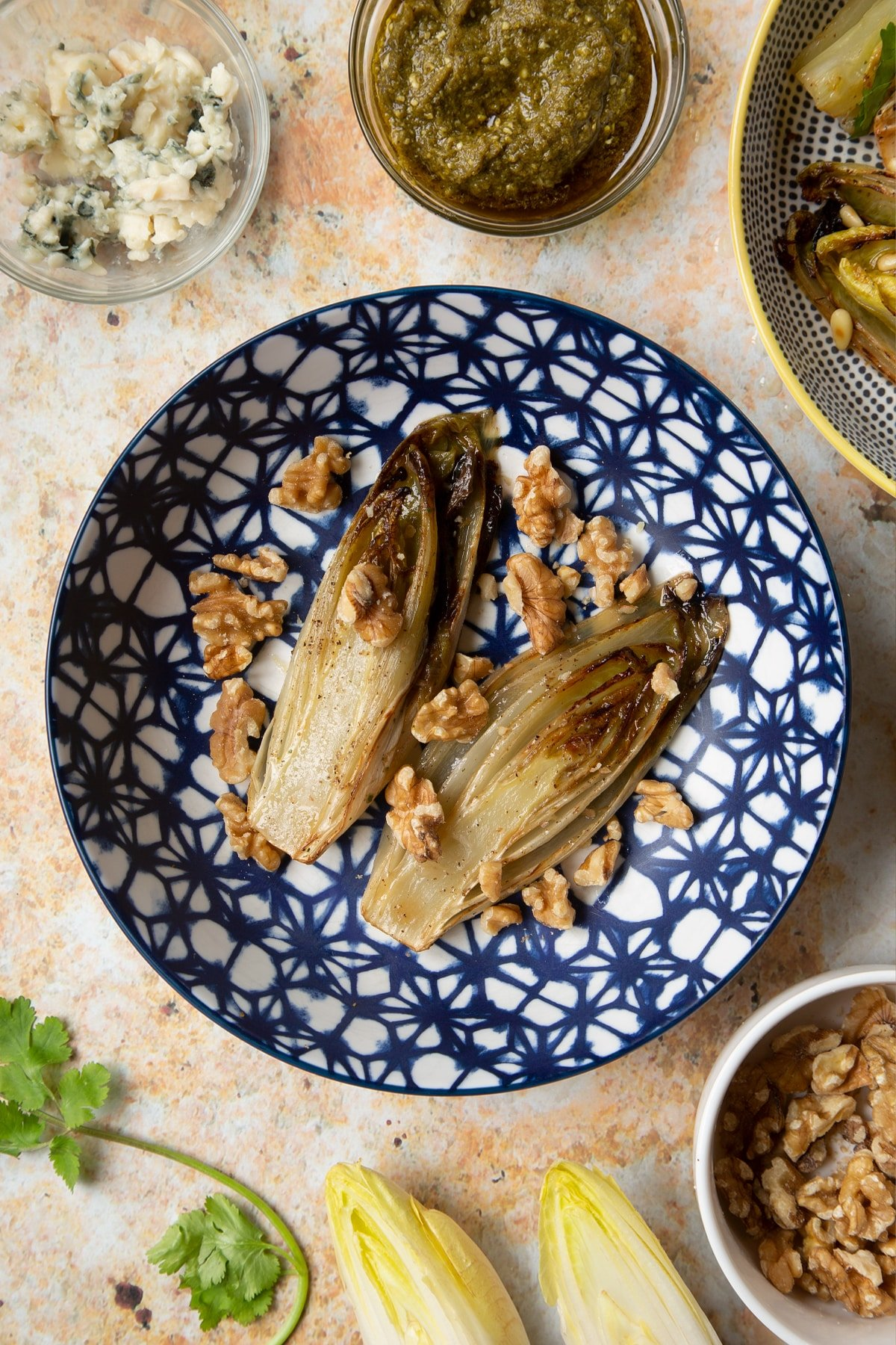 Braised chicory in a bowl with walnuts.