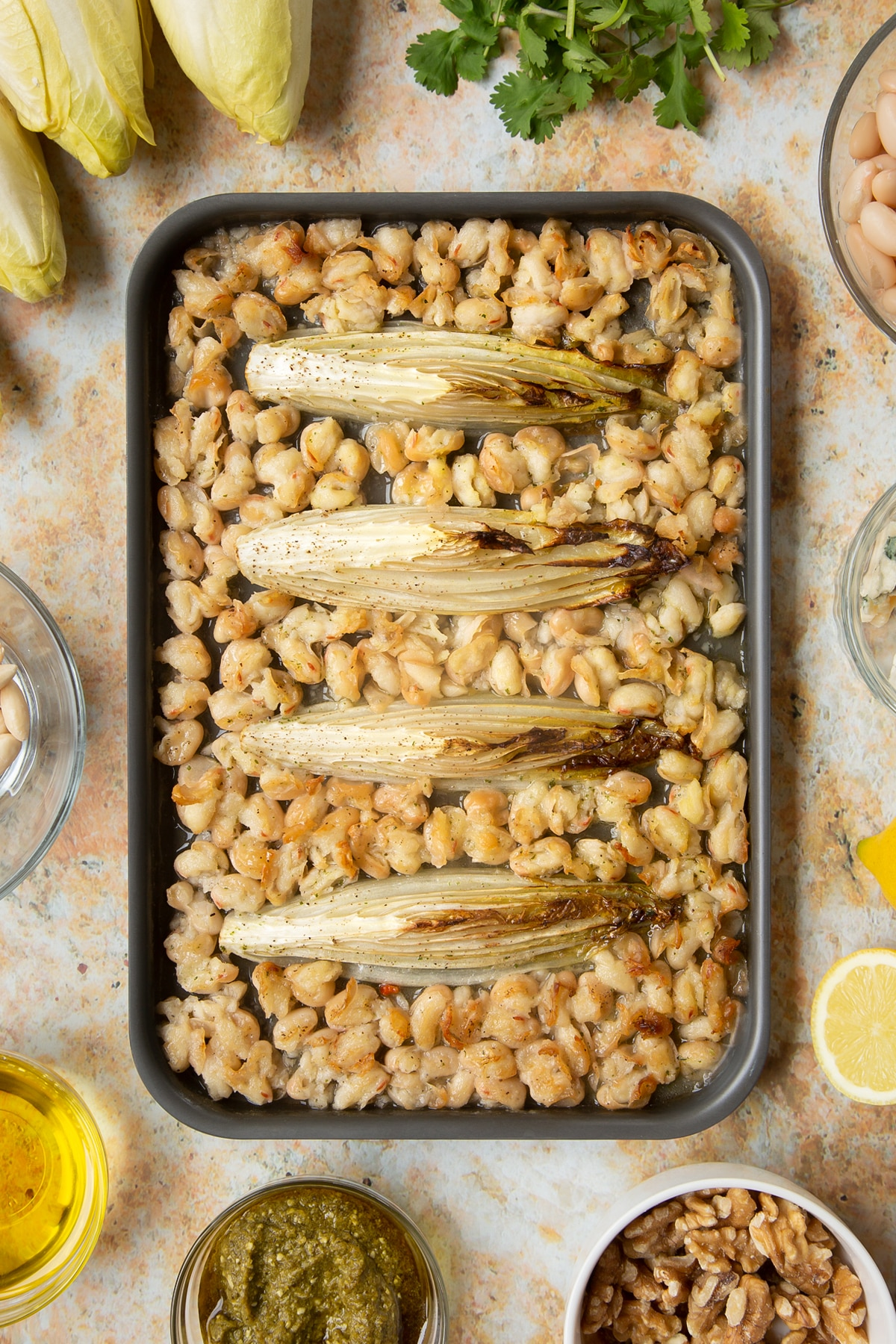 Braised chicory and cannellini beans on a tray.