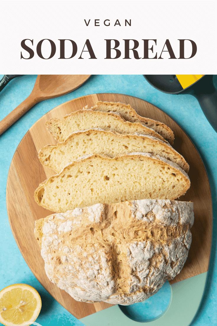 Vegan soda bread sliced on a board. Caption reads: vegan soda bread.