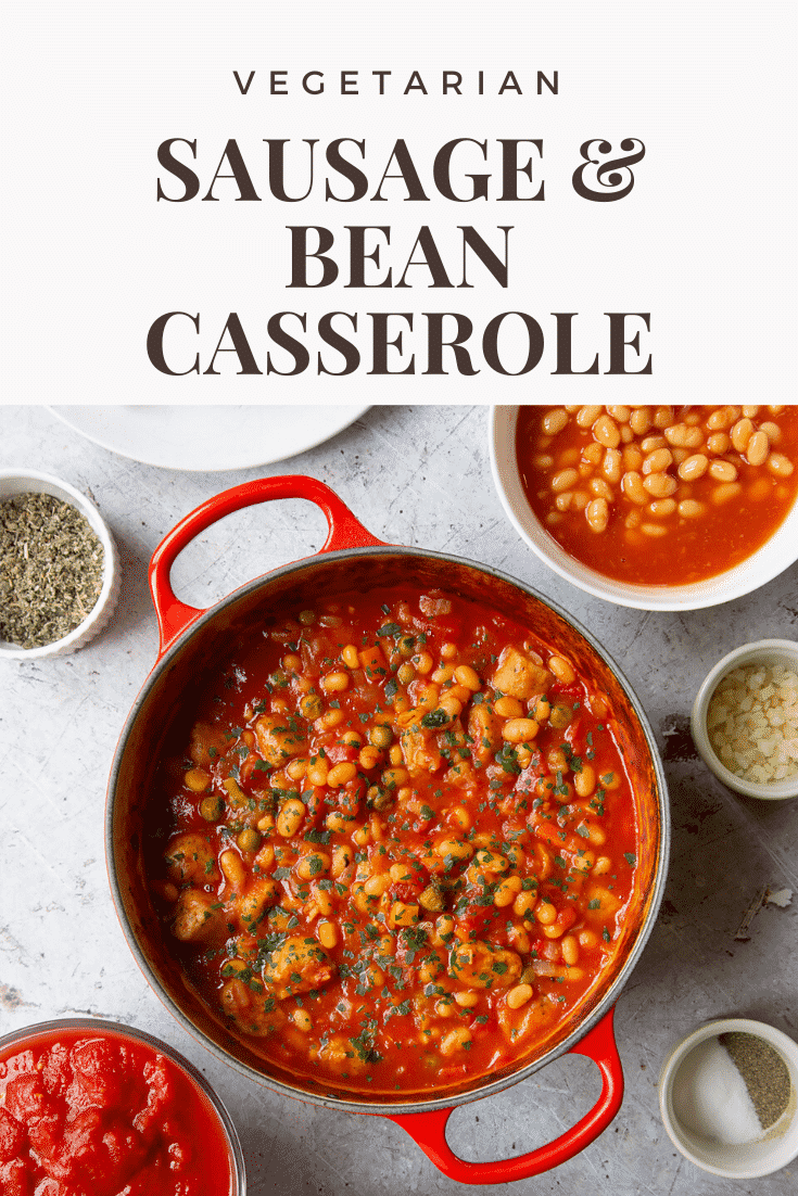 Veggie sausage and bean casserole in a large red pot. Caption reads: vegetarian sausage & bean casserole