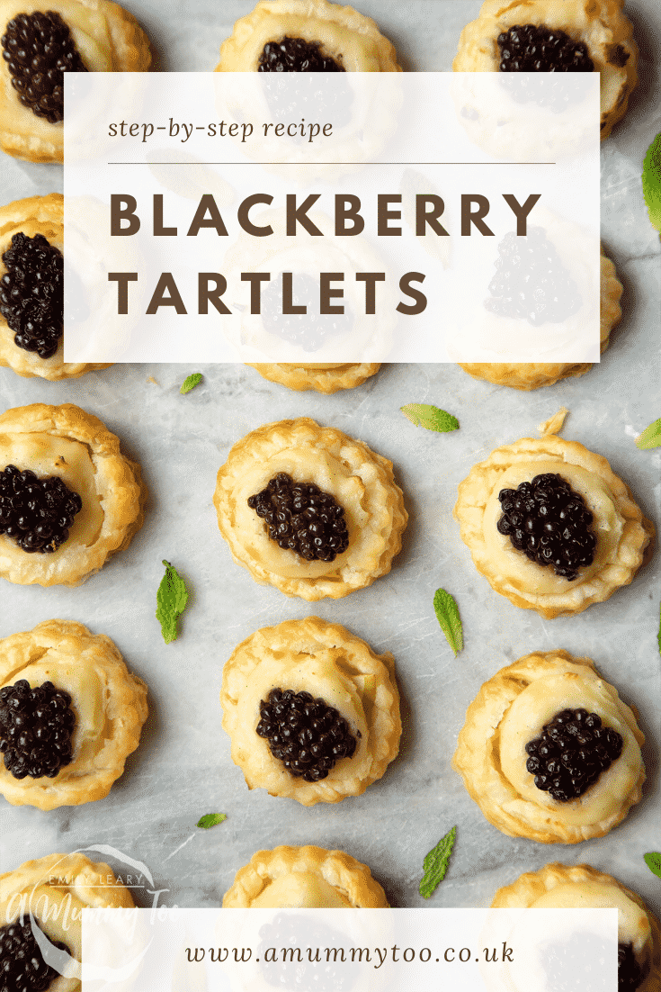 Blackberry tartlets on a marble board with tiny mint leaves scattered around them. Caption reads: step-by-step recipe blackberry tartlets.