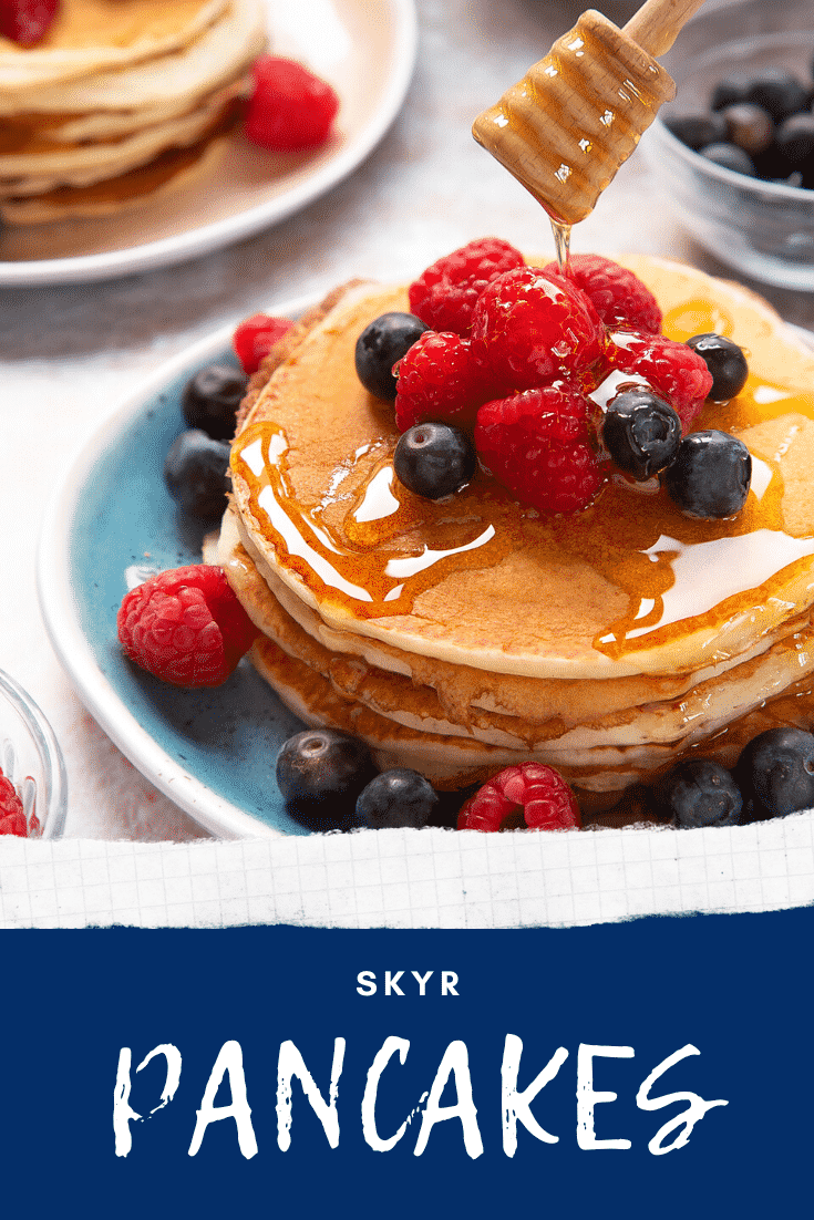 Skyr pancakes served with berries and honey. Caption reads: skyr pancakes