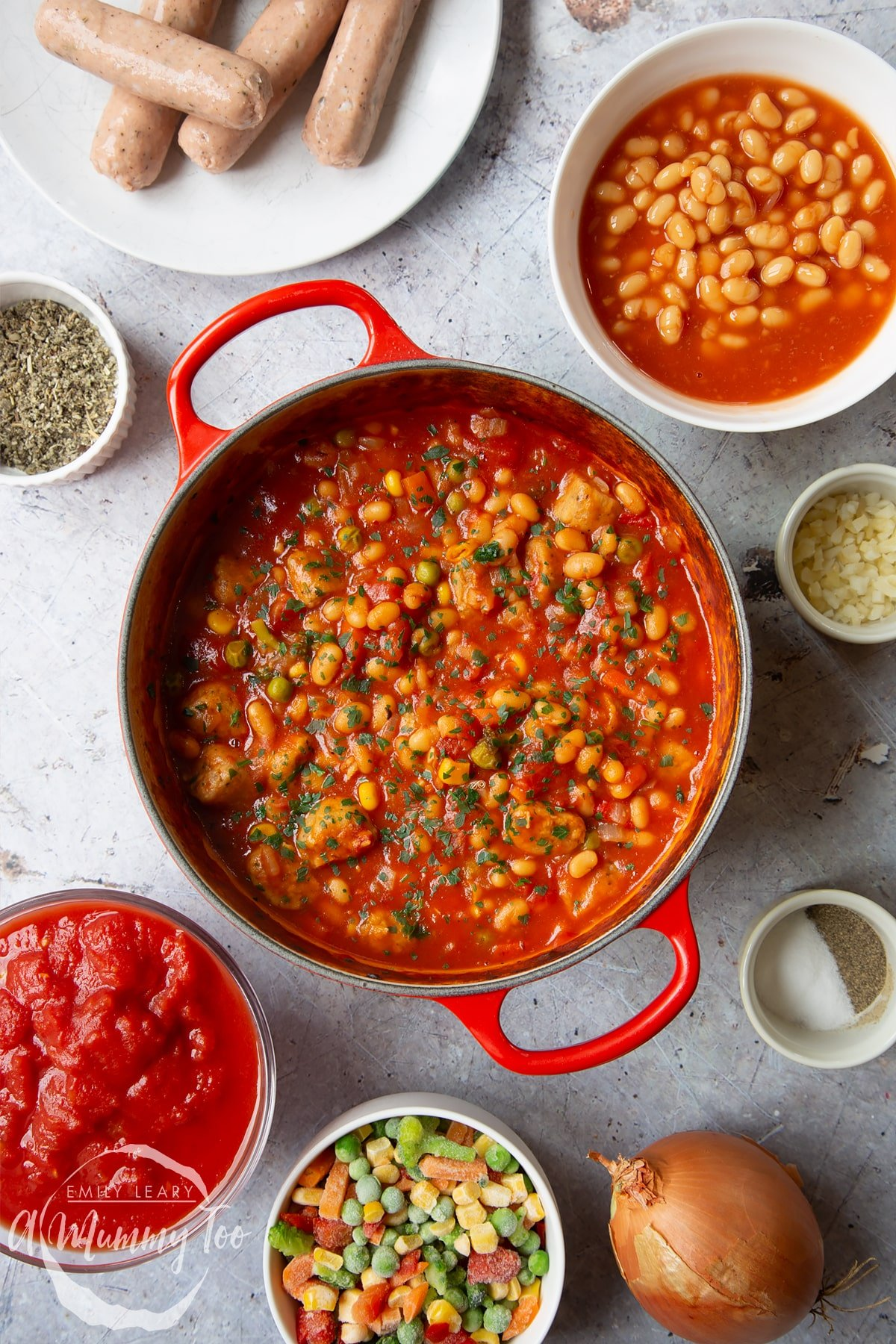 Veggie sausage and bean casserole in a large red pot.