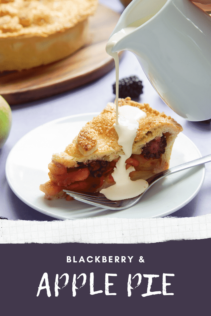 A slice of apple and blackberry pie on a white plate with a fork. Cream has been poured on top. Caption reads: blackberry & apple pie