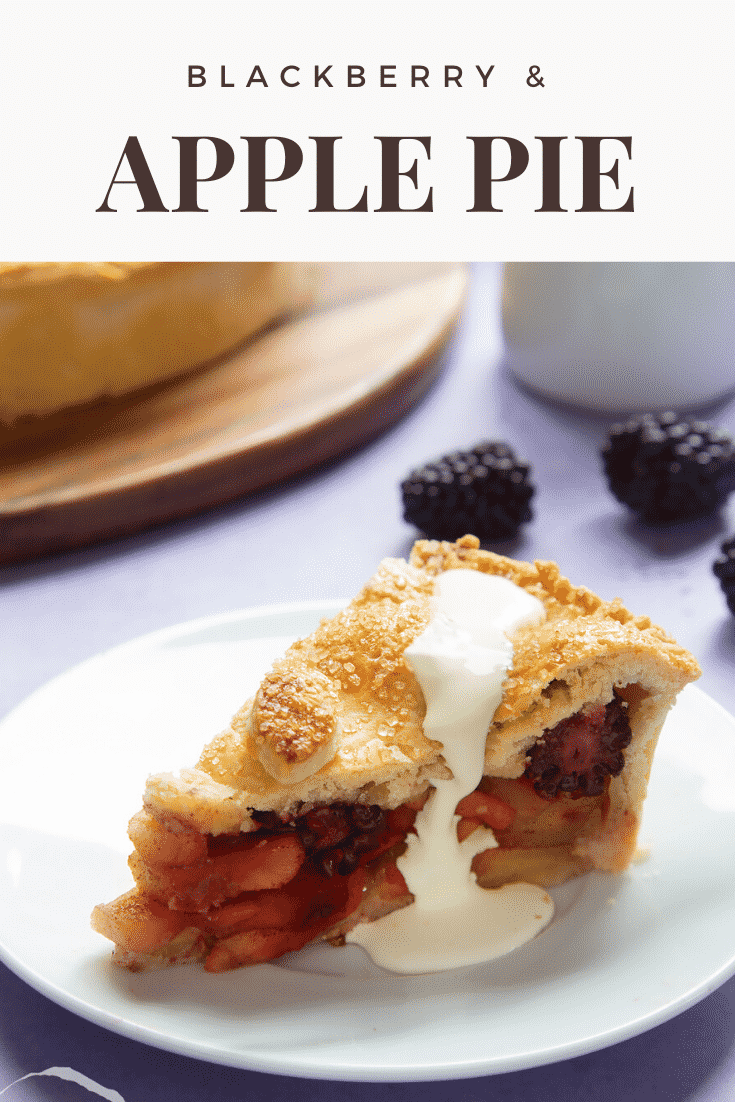 A slice of apple and blackberry pie on a white plate. Cream has been poured on top. Caption reads: blackberry & apple pie