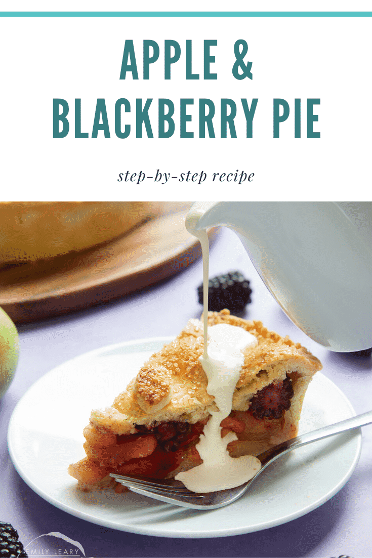 A slice of apple and blackberry pie on a white plate with a fork. Cream has been poured on top. Caption reads: apple & blackberry pie step-by-step recipe