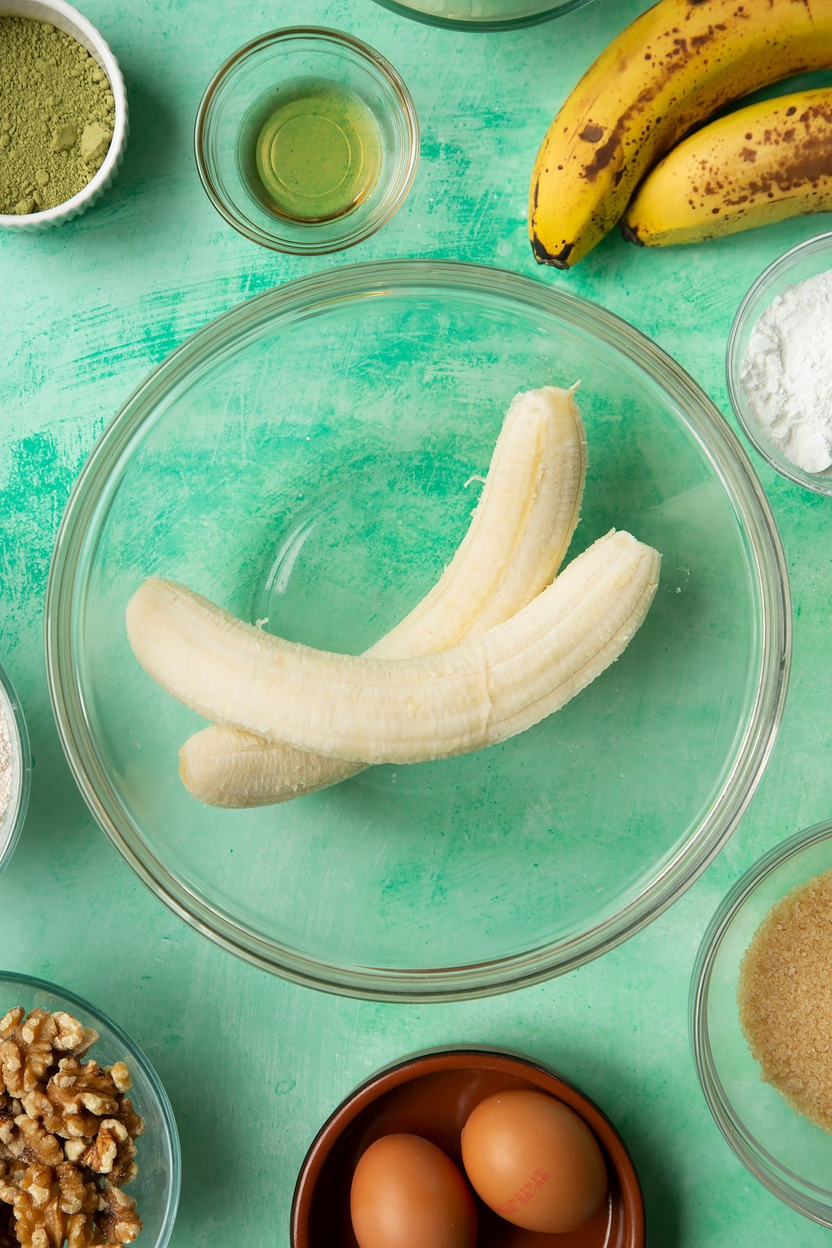 Overhead shot of blended bananas in a large clear bowl