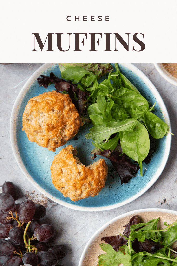 Easy cheese muffins on a plate with salad. There is a bite out of one. Caption reads: cheese muffins