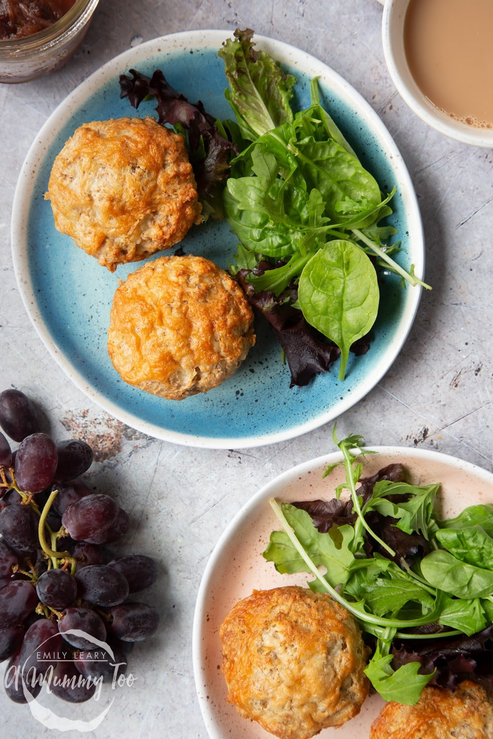 Easy cheese muffins served to two plates with leafy salad.