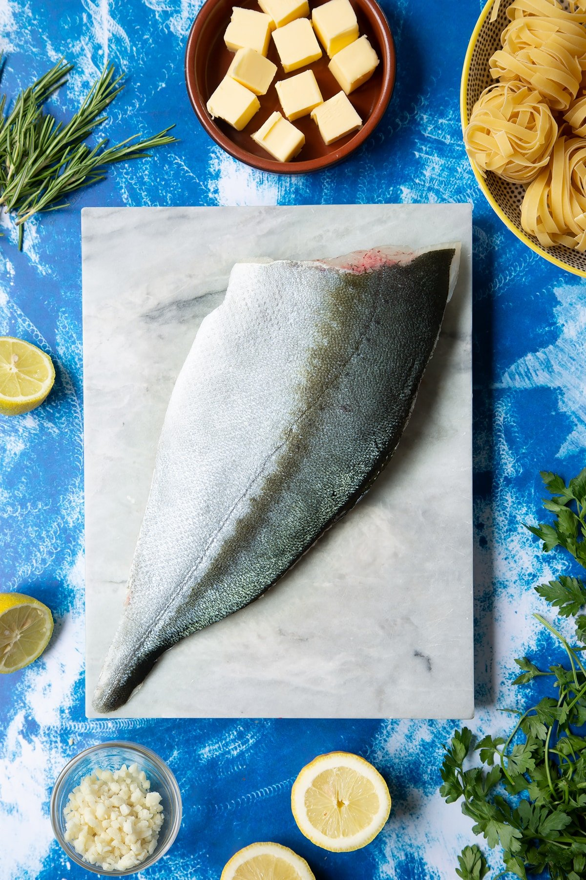 A Dutch Yellowtail fillet on a marble board, skin side up