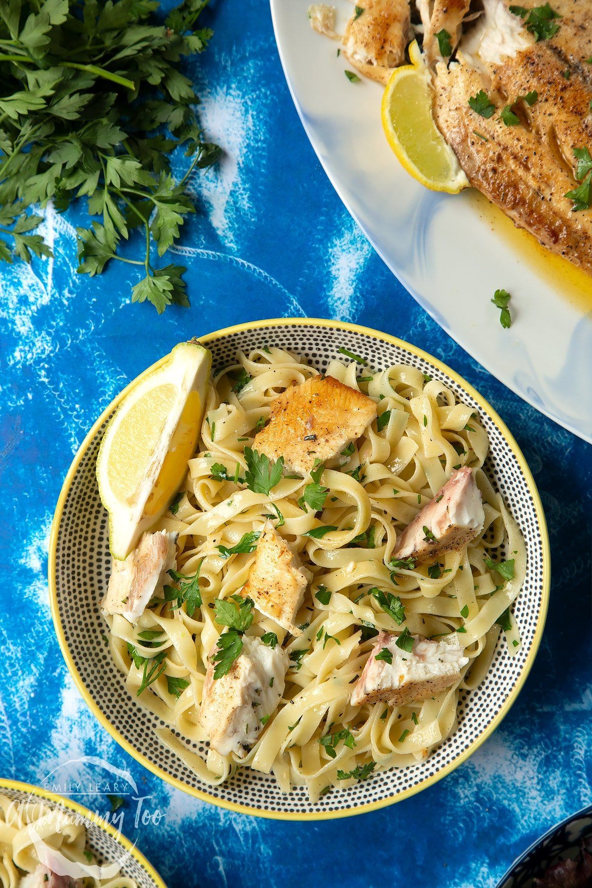 Pan-fried Yellowtail tagliatelle served in a wide, shallow bowl.