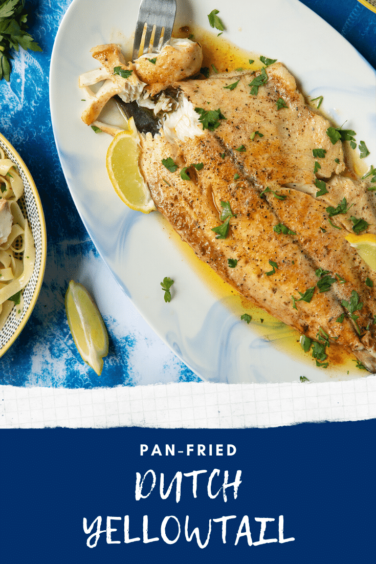 Pan-fried Yellowtail on a large oval serving dish. A fork delves into the buttery fish. Caption reads: pan-fried Dutch Yellowtail