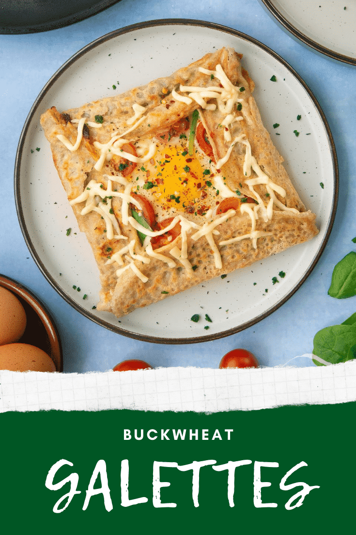 A view from above of a buckwheat filled with spinach, tomatoes, cheese and a lightly cooked egg. Caption reads: buckwheat galettes