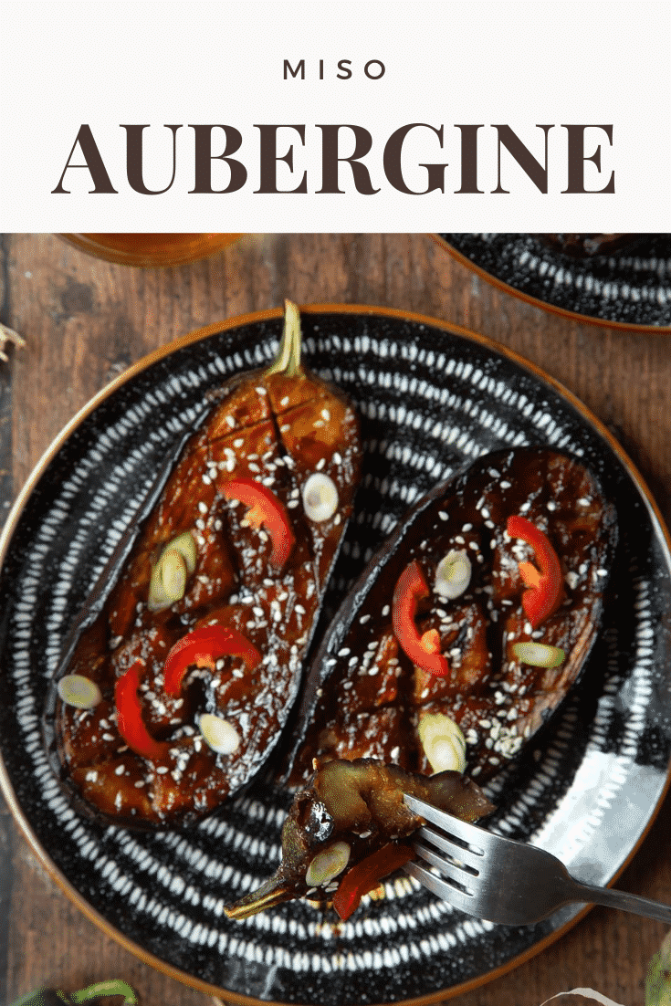 Two slices of miso aubergine on a plate, topped with chilli, springs onions and sesame seeds. Caption reads: miso aubergine