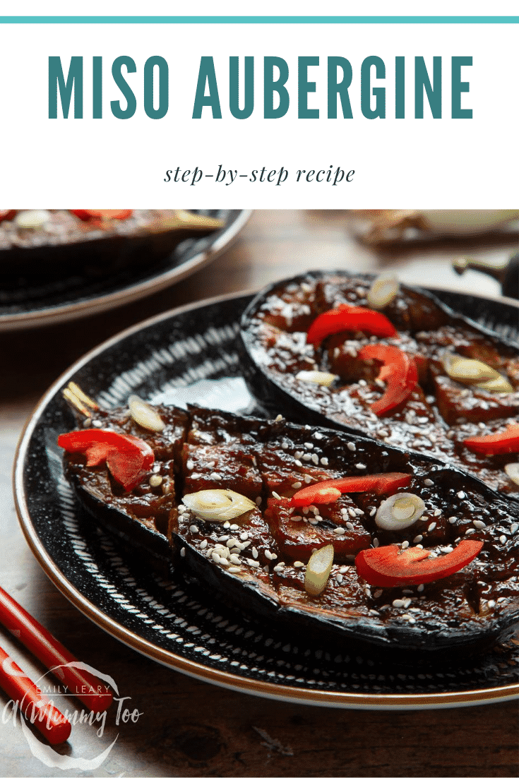 Two slices of miso aubergine on a plate, topped with chilli, springs onions and sesame seeds. Caption reads: miso aubergine step-by-step recipe