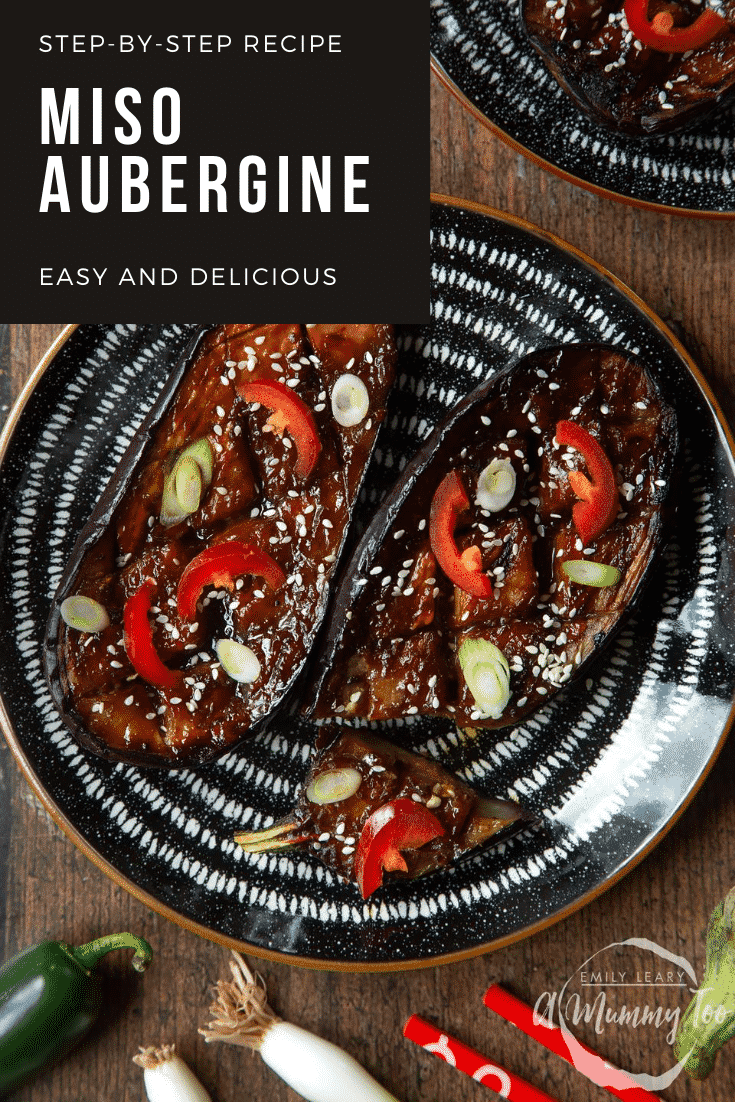 Two slices of miso aubergine on a plate, topped with chilli, springs onions and sesame seeds. One piece has been sliced. Caption reads: step-by-step recipe miso aubergine easy and delicious