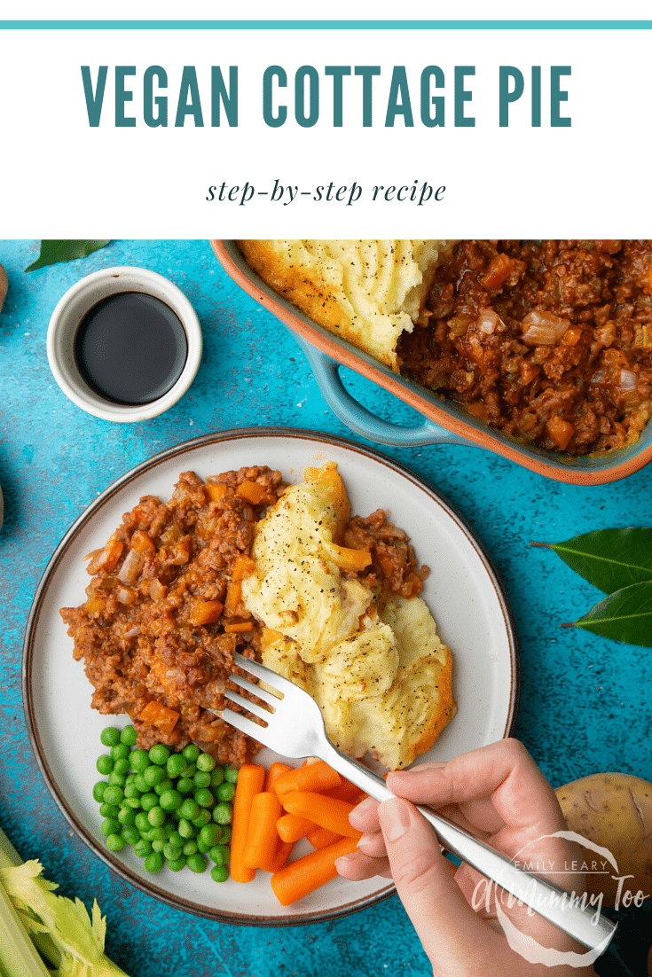 Vegan cottage pie served on a plate with peas and carrots. A hand with a fork takes some. Caption reads: vegan cottage pie step-by-step recipe