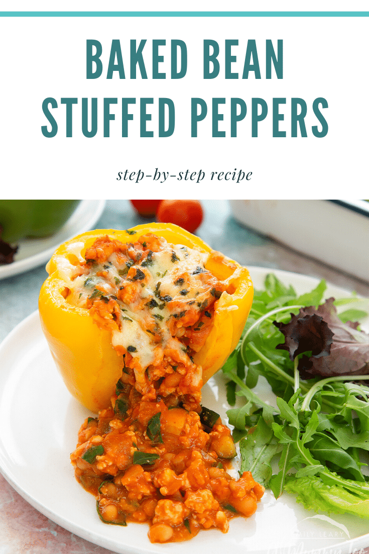 A yellow stuffed peppers served on a white plate. The filling spills out. Caption reads: Baked bean stuffed peppers step-by-step recipe