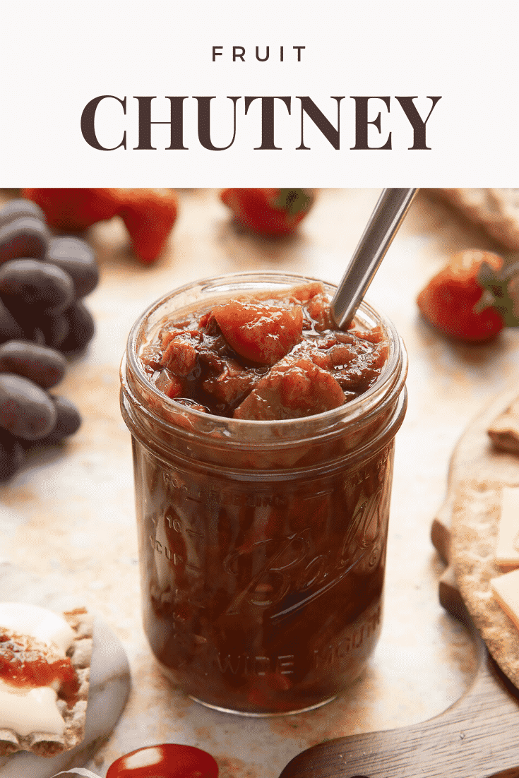 Fruit chutney recipe in a jar with a spoon. Caption reads: fruit chutney