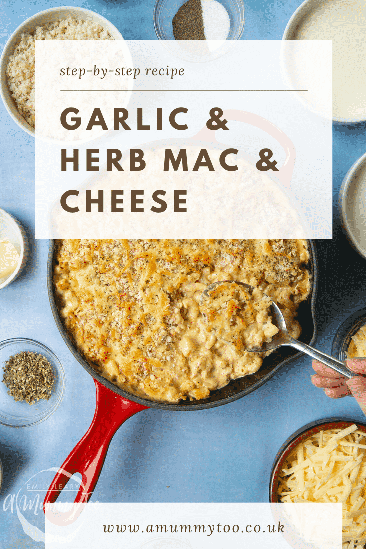 A red skillet with garlic and herb mac and cheese and a spoon delving into it. Caption reads: step-by-step recipe garlic & herb mac & cheese