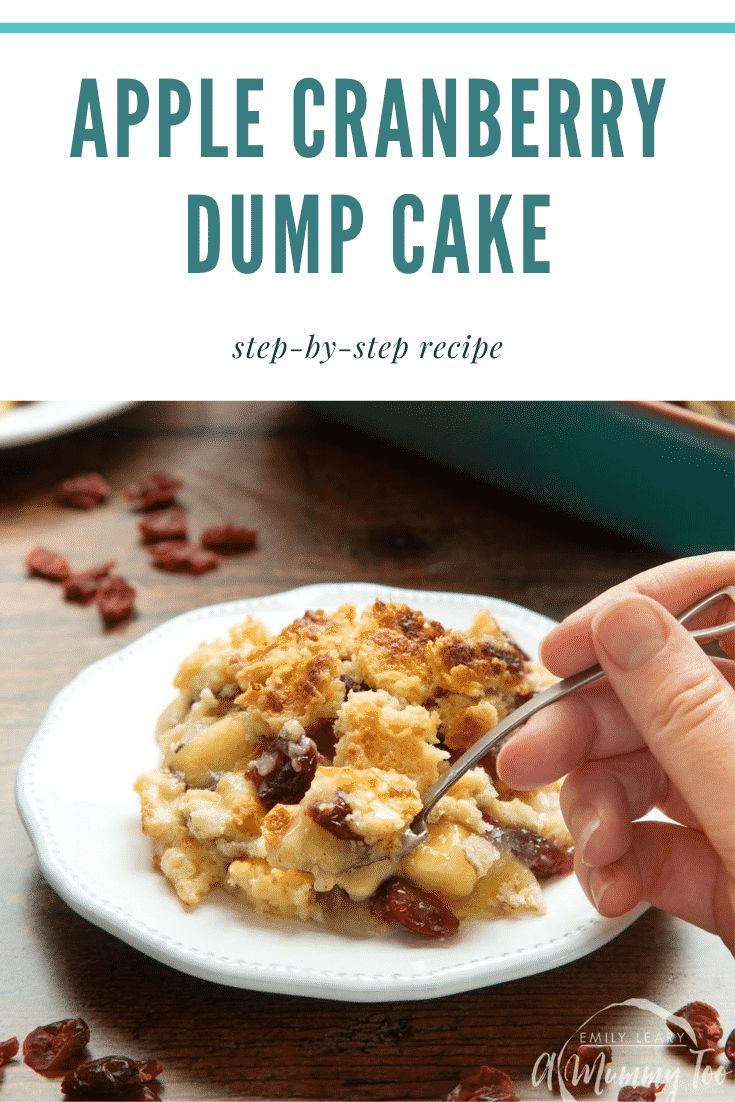 Apple cranberry dump cake served onto a small white plate. A hand holds a spoon, delving into the cake. Caption reads: apple cranberry dump cake step-by-step recipe