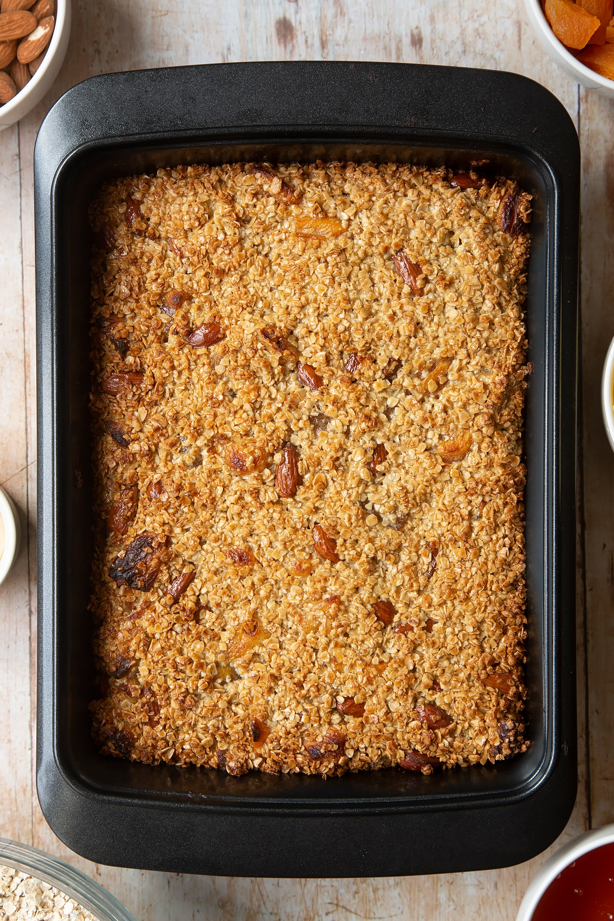 Overhead shot of Apricot oat in a black baking tin