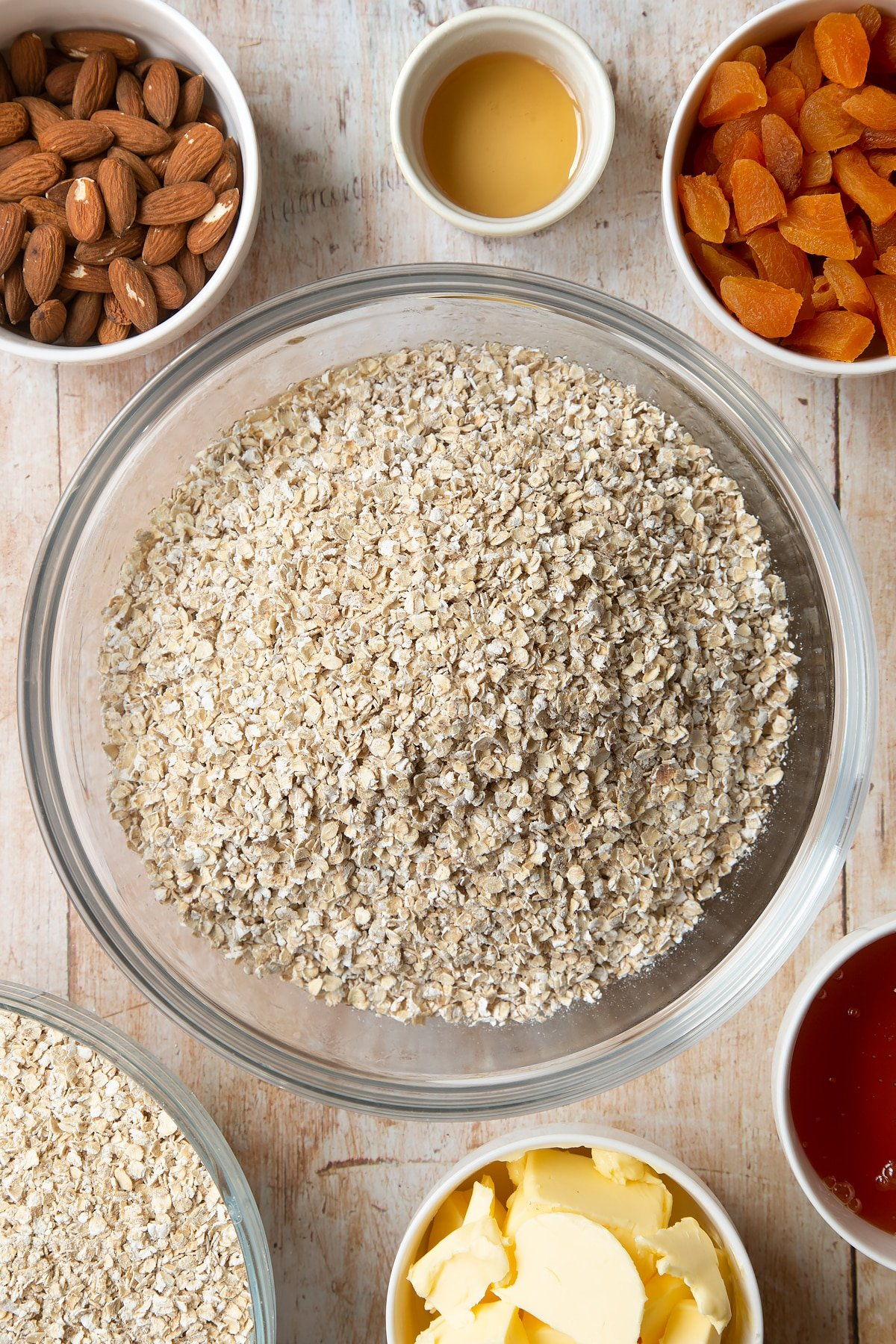 Overhead shot of oats in a large clear bowl