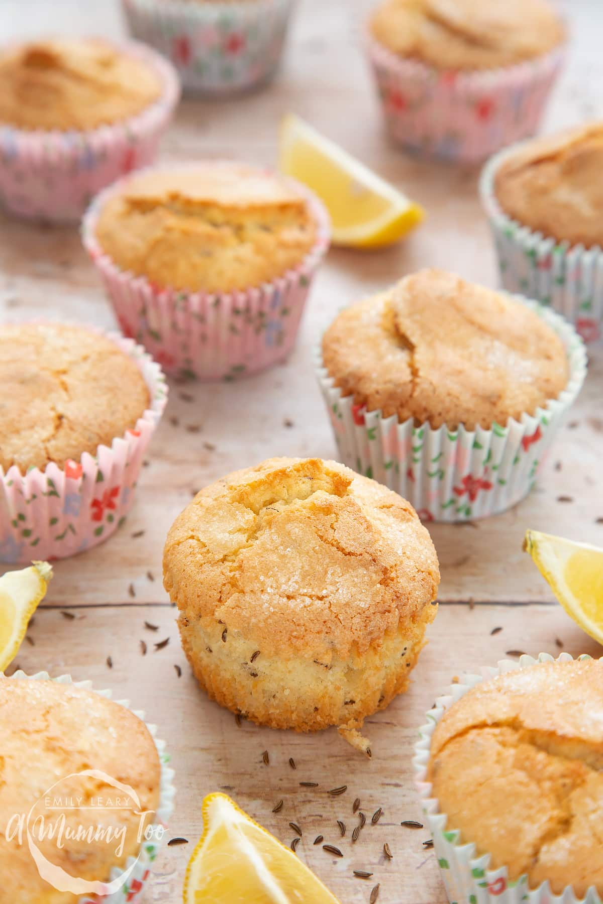 Front angle shot of Caraway muffins and lemons with a mummy too logo in the lower-left corner