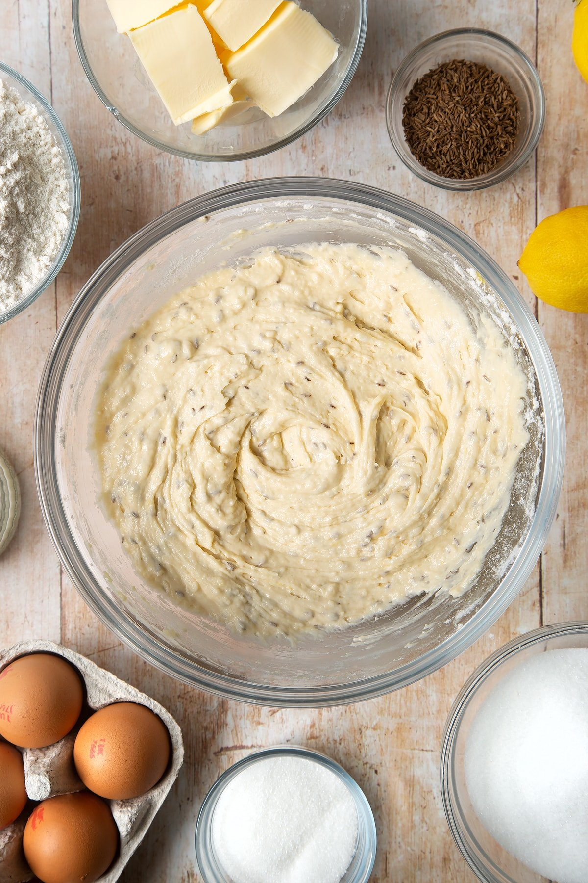 Overhead shot of muffin mix in a large clear bowl