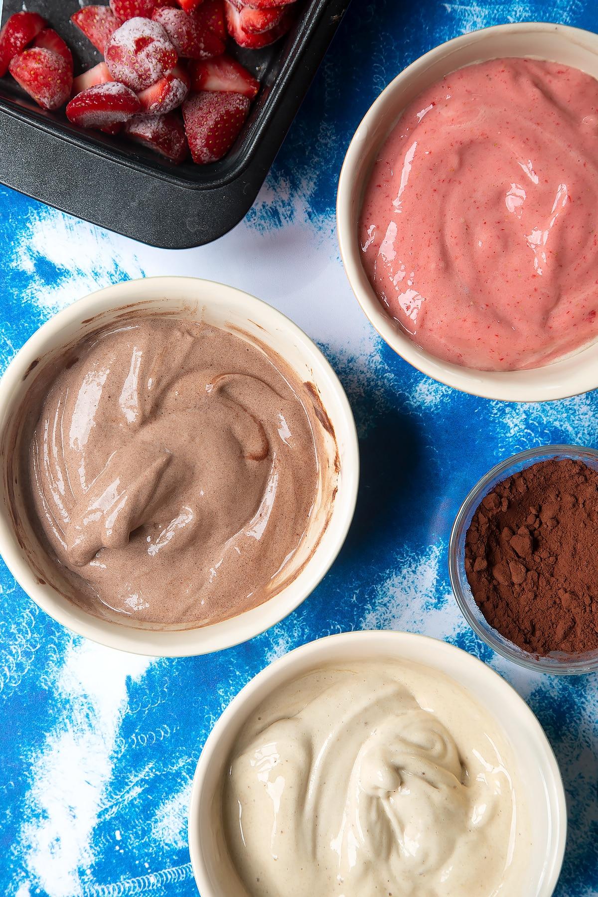 Banana ice cream in three bowls - one chocolate, one vanilla and one strawberry.