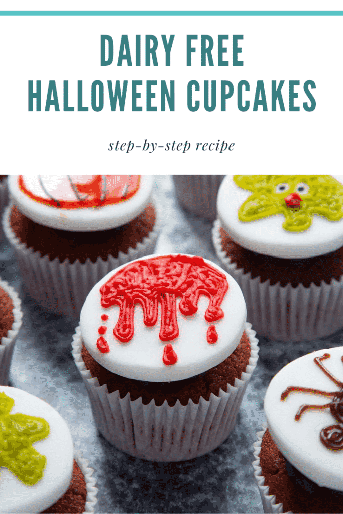 Red velvet cupcakes topped with chocolate frosting and white fondant discs decorated with icing pens. The cupcake in the foreground has a dripping blood design. Caption reads: Dairy free Halloween cupcakes. Step-by-step recipe.