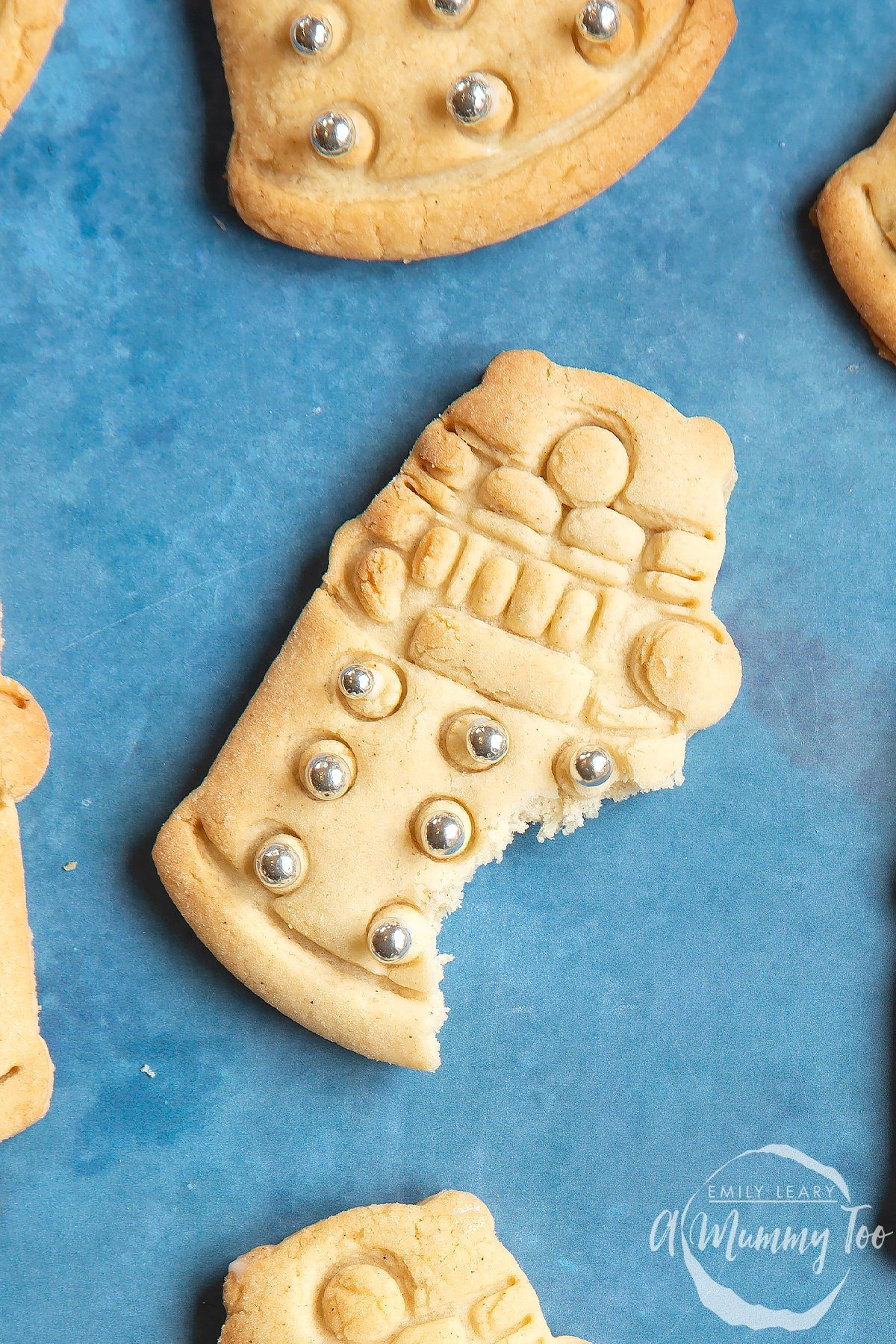 Close up of a Dalek cookie with a bite out of it.
