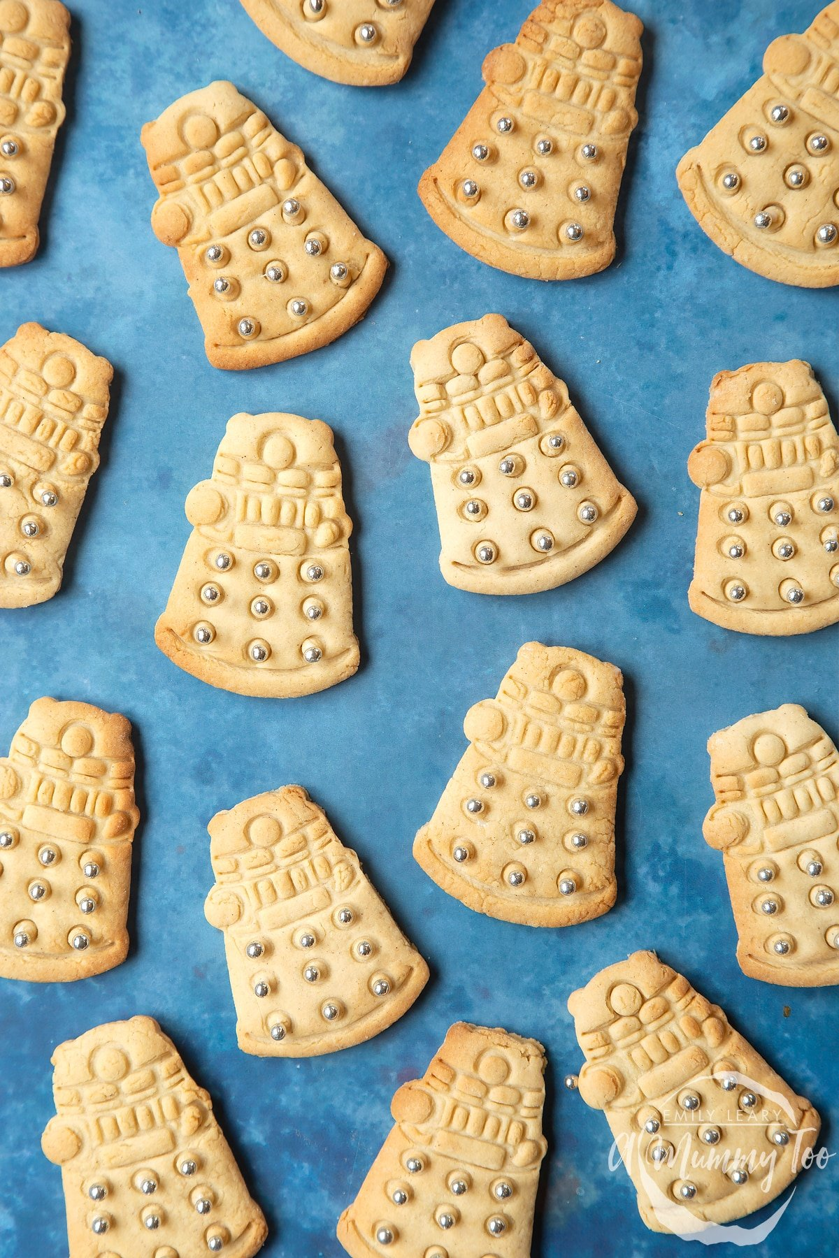 Dalek sugar cookies decorated with silver candy balls.