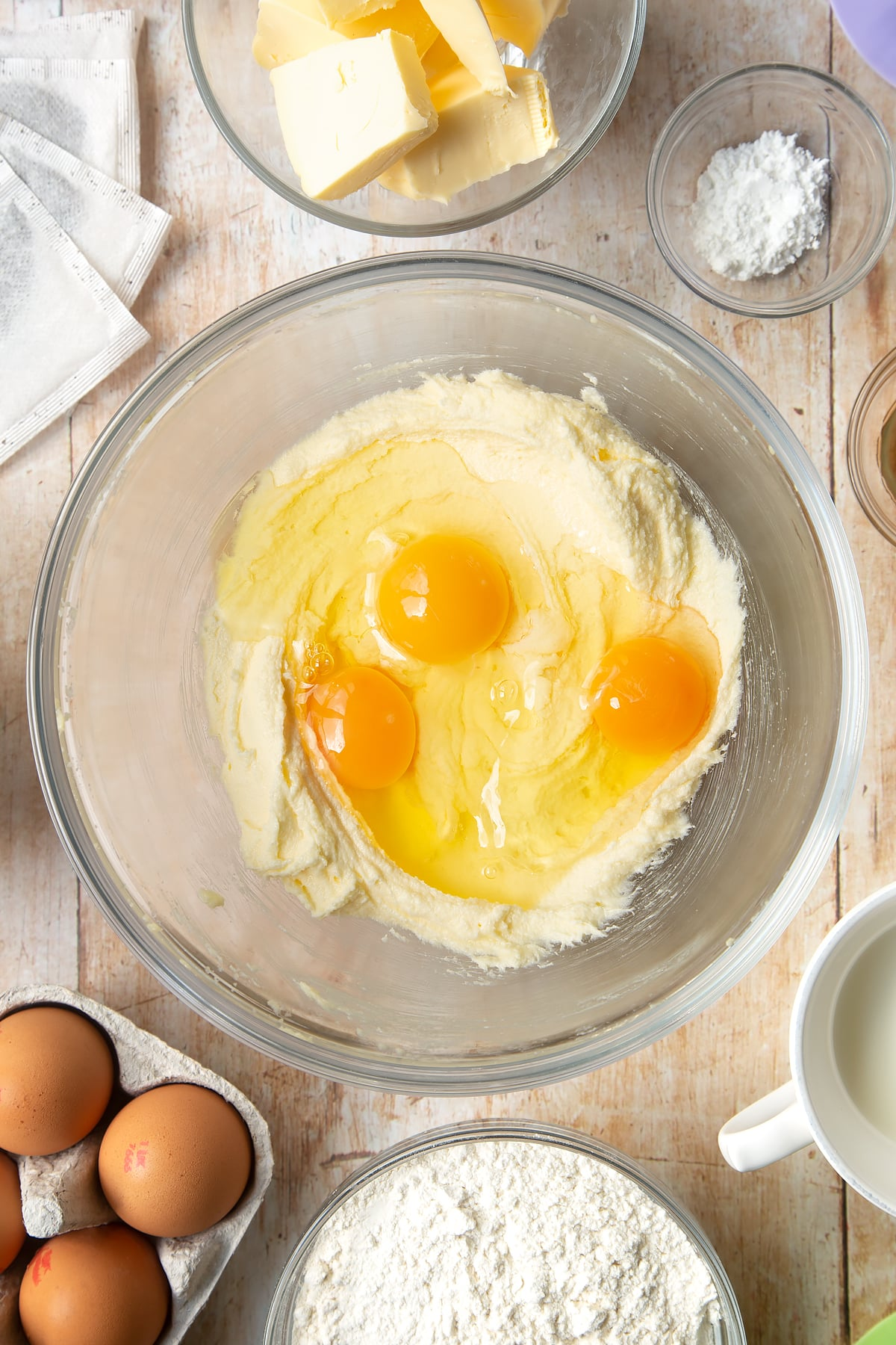 Overhead shot of eggs and mixed butter in a large bowl