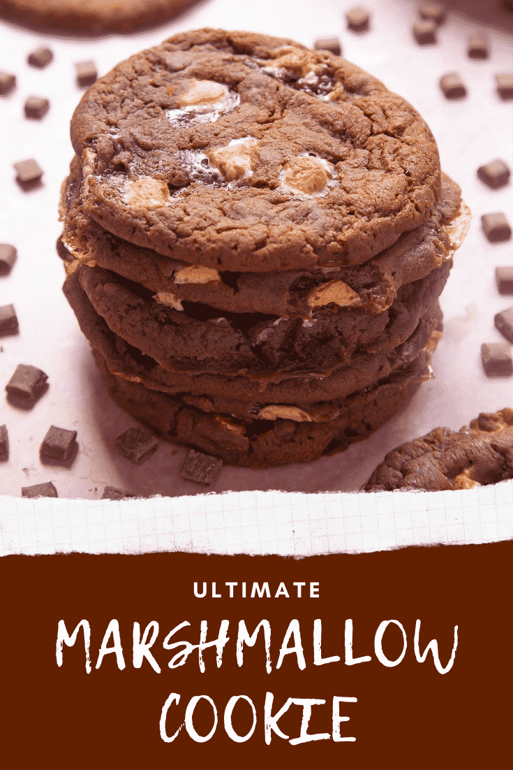 Forward shot of a stack of ultimate marshmallow cookies. At the bottom of the image there's some text describing the image for Pinterest.
