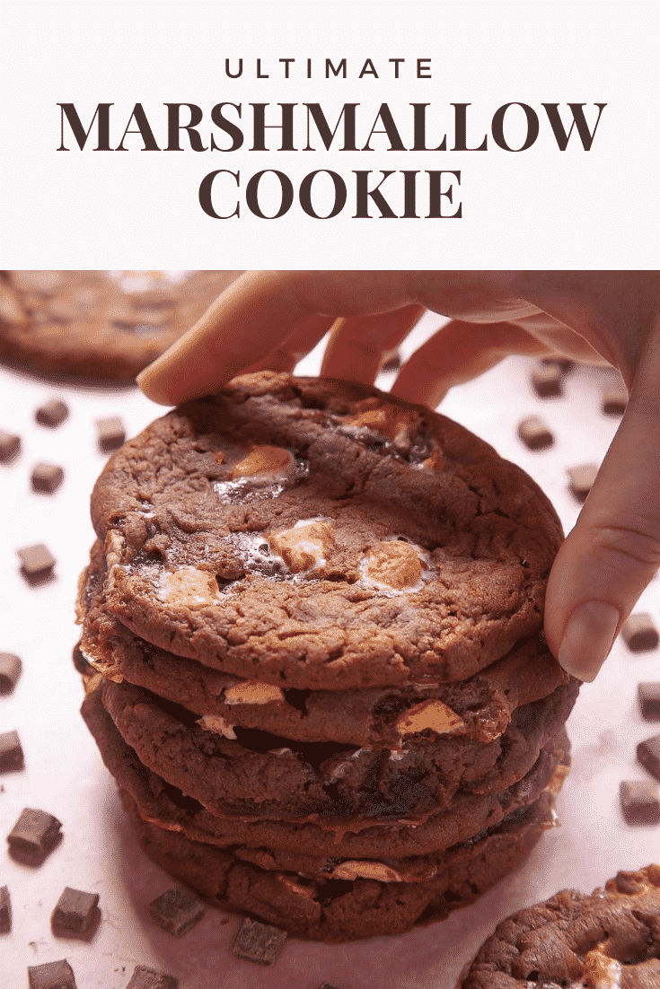 Forward shot of a stack of ultimate marshmallow cookies. At the top of the image there's some text describing the image for Pinterest.