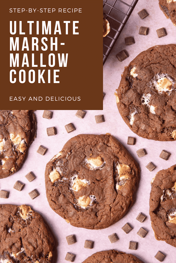 Overhead shot of a stack of ultimate marshmallow cookies. At the top right hand side of the image there's some text describing the image for Pinterest.