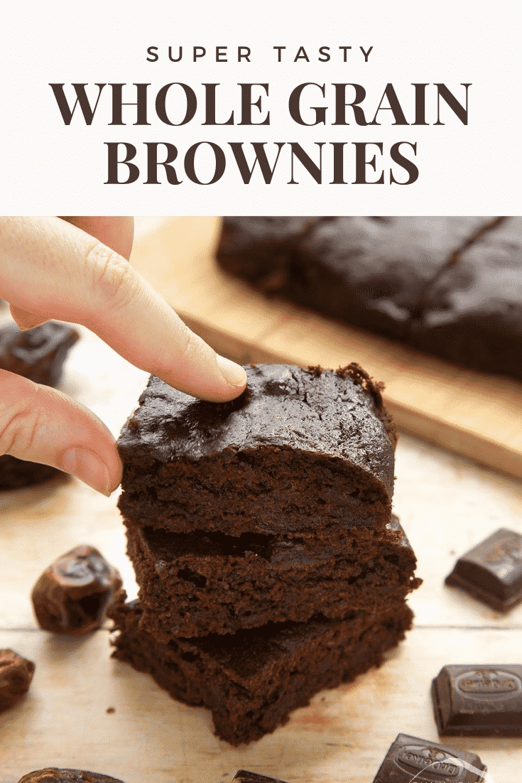 A stack of whole grain brownies made with dates and dark chocolate. A hand reaches to take one. Caption reads: super tasty whole grain brownies
