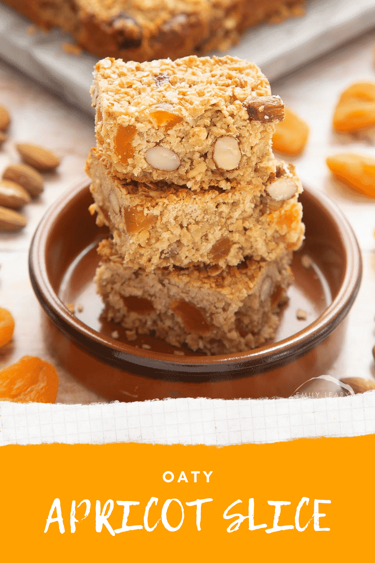 Graphic text APRICOT OAT SLICE EASY AND DELICIOUS above Overhead shot of a hand holding an Apricot oat slice served in a marble slab
