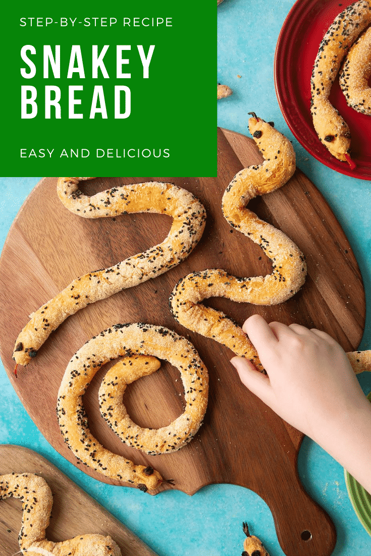 A hand holds a bread snake amongst more on a wooden board. Caption reads: step-by-step recipe snake breadsticks easy and delicious