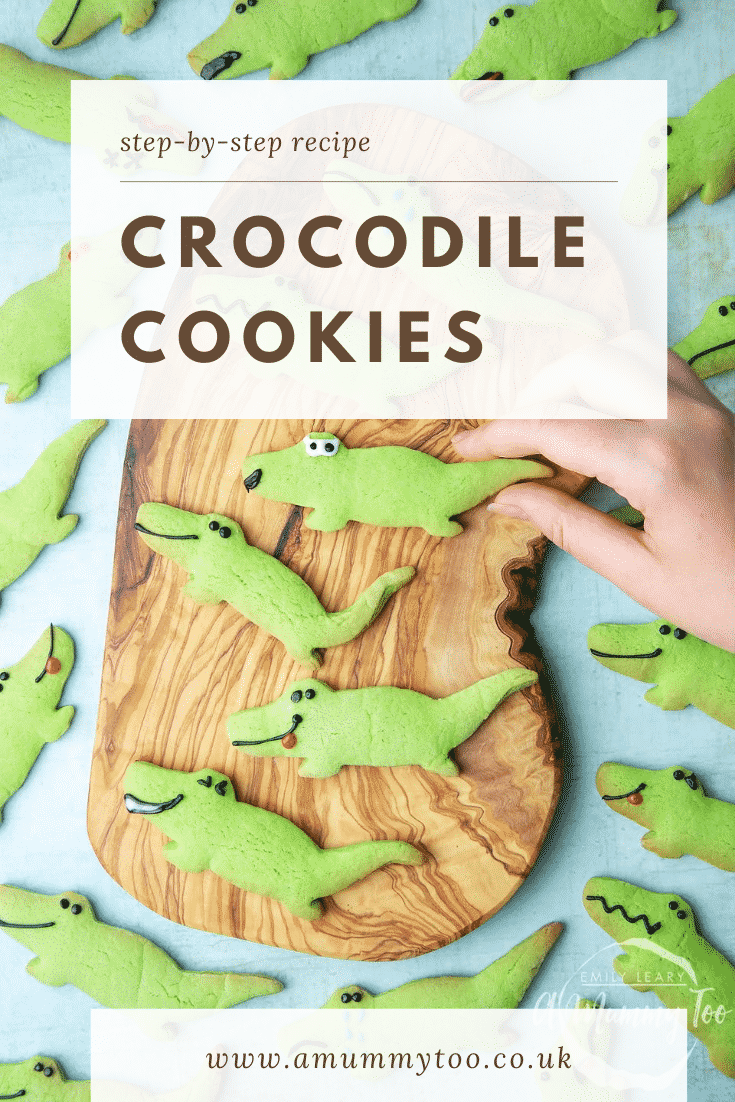 graphic text step-by-step recipe CROCODILE COOKIES above Overhead shot of a hand holding a green Crocodile sugar cookie  with website URL below