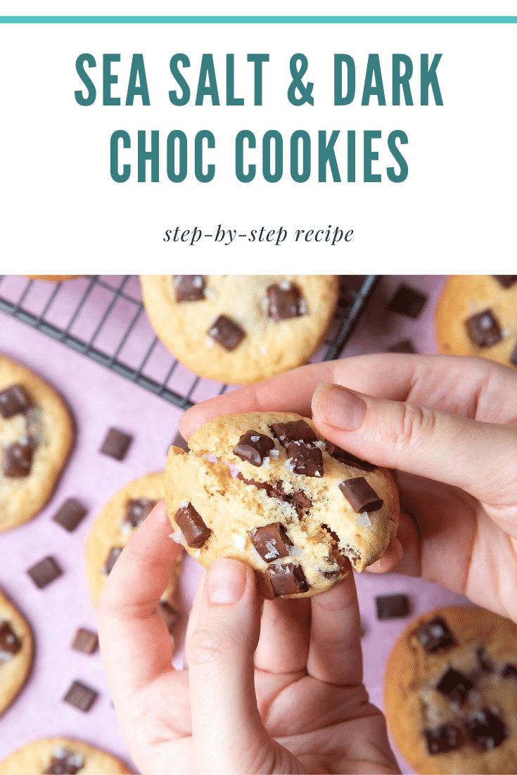 graphic text SEA SALT & DARK CHOC COOKIE step-by-step recipe above Overhead shot of a hand breaking sea salt choco cookies