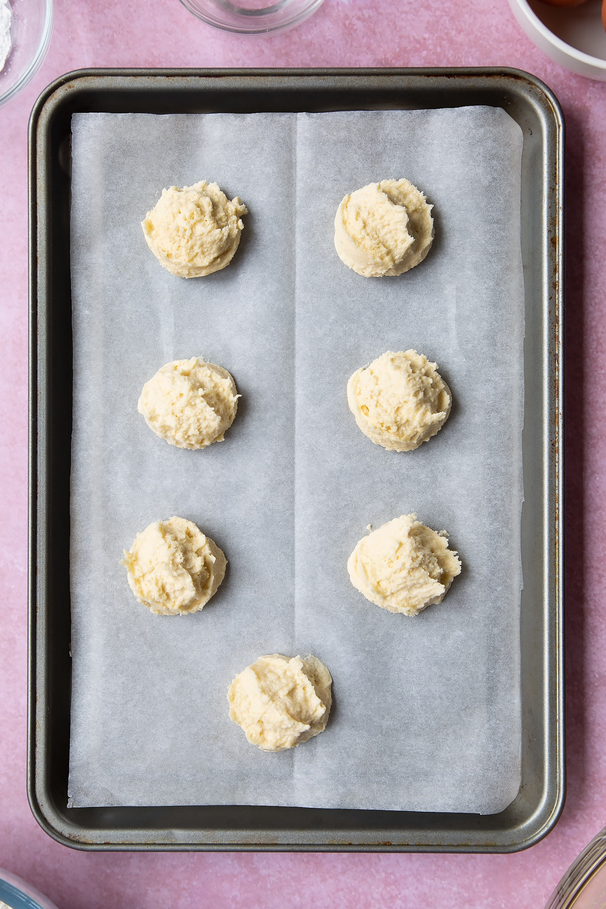 Overhead shot of cookie dough ball in a baking tray