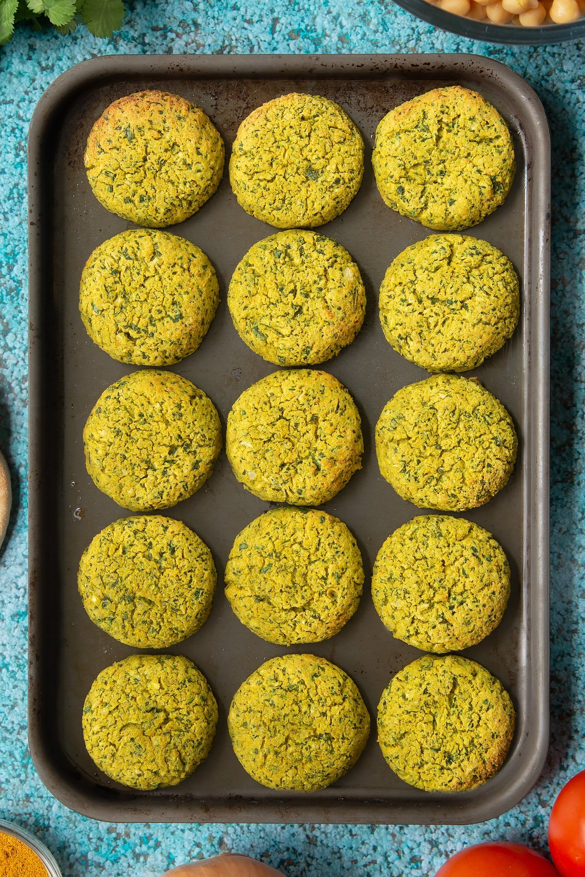 Cooked gluten-free falafel on a baking tray.