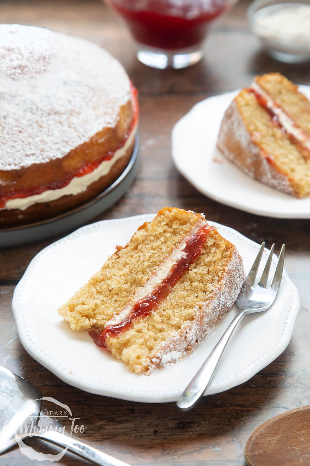 A slice of golden syrup sponge cake on a white decorate plate with a cake fork on the side.