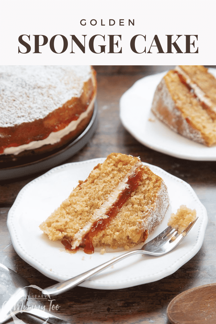 graphic text GOLDEN SPONGE CAKE above a golden sponge cake with jam and icing with a mummy too logo in the lower-left corner
