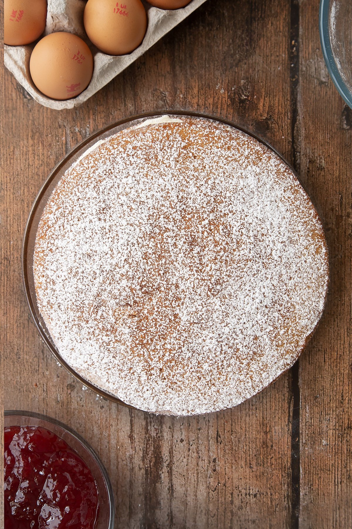 Overhead shot of the golden syrup sponge cake having been dusted with icing sugar.