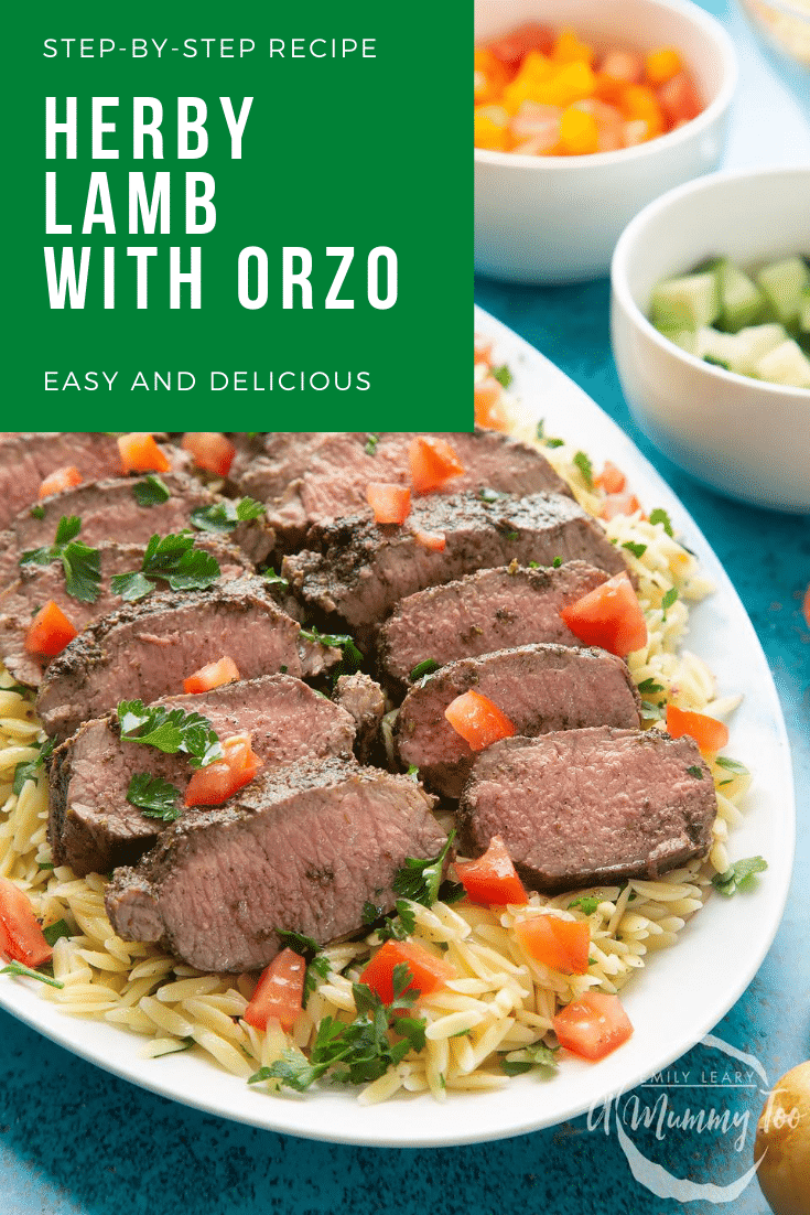 Slices of herby lamb arranged on a bed of orzo on an oval platter. A fork lifts some lamb. Caption reads: step-by-step recipe herby lamb with orzo easy and delicous