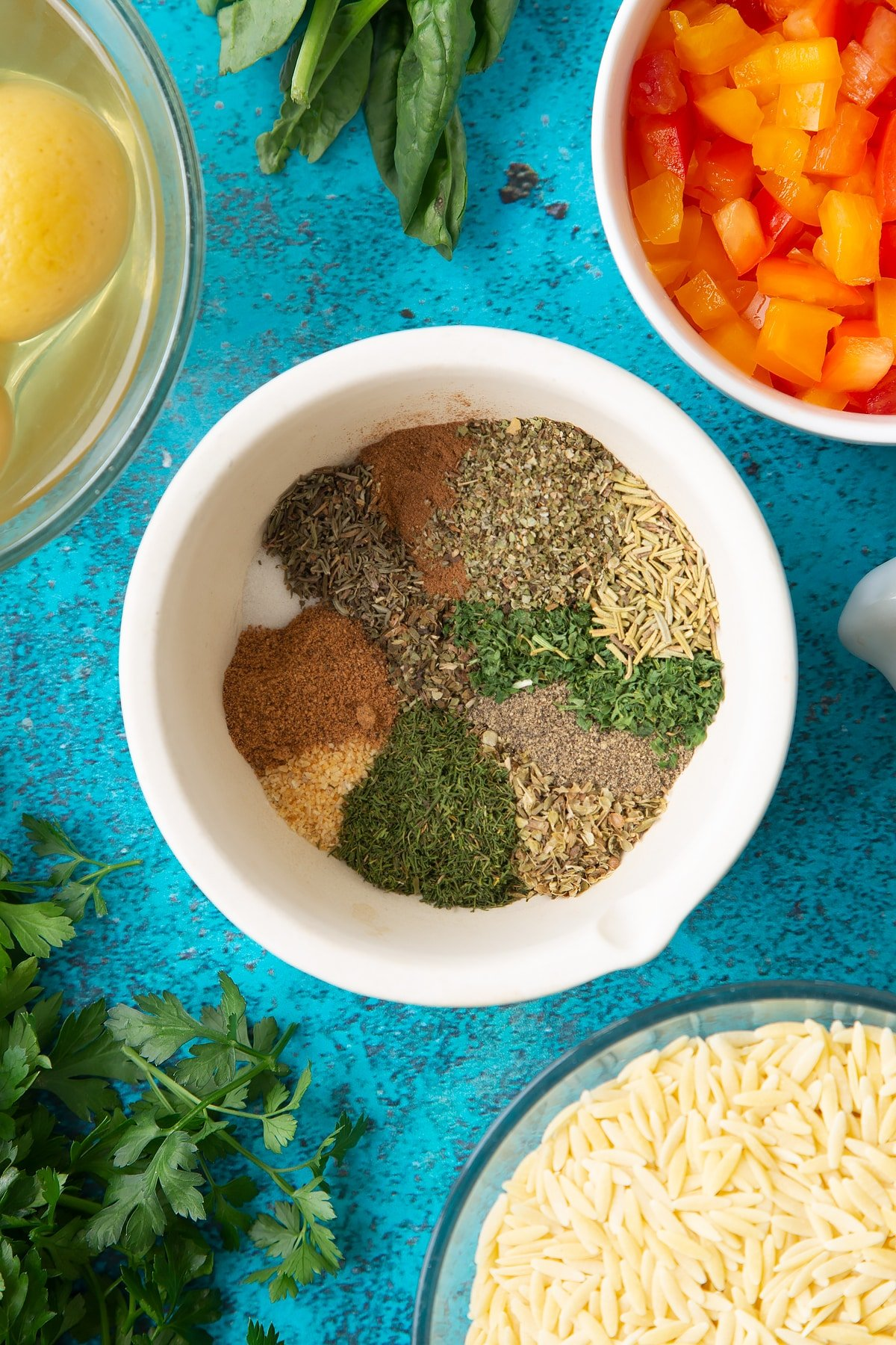 Spices and herbs in a mortar.