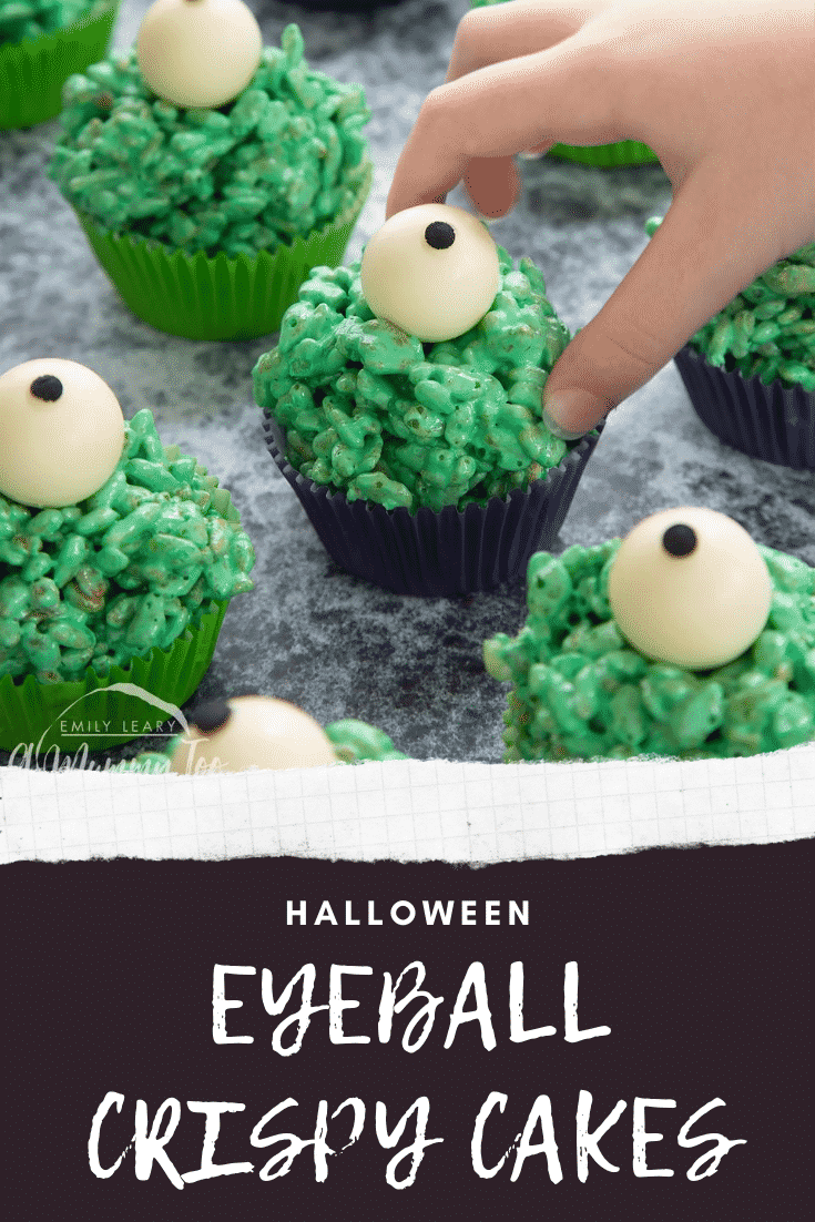 Halloween crispy cakes, dyed green and topped with white chocolate spheres decorated to look like eyeballs. A little hand reaches for one. Caption reads: Halloween eyeball crispy cakes